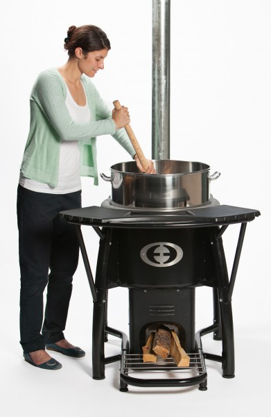 Woman Stirring SaverPro Wood Stove
