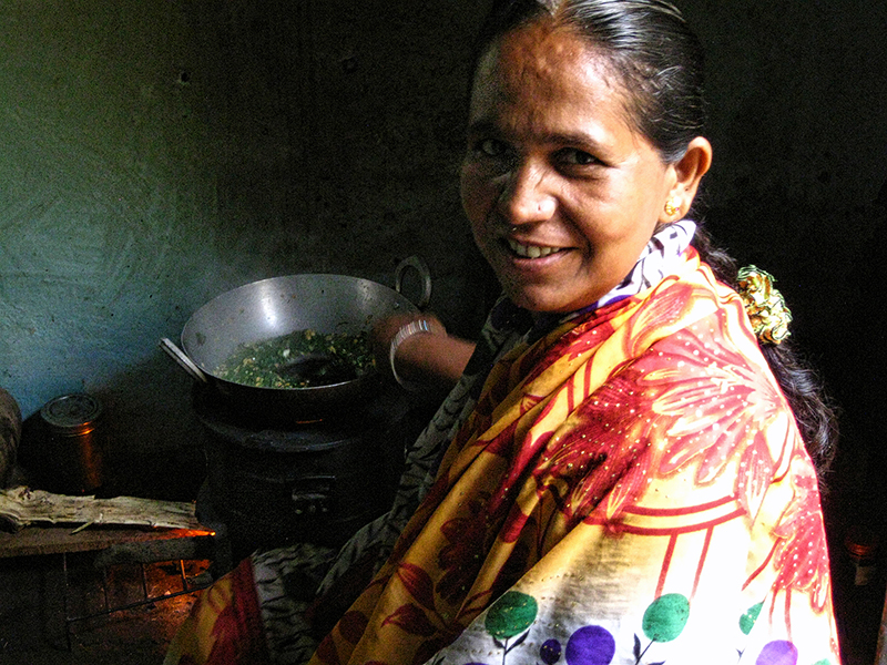 Woman in Paithan India using Envirofit cookstove