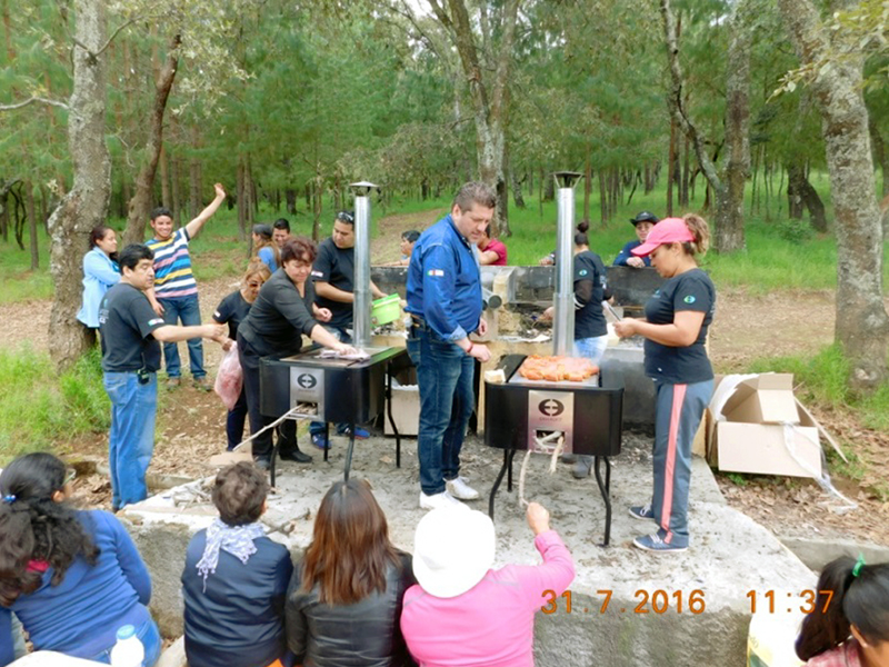 Envirofit employees cook during reforestation project