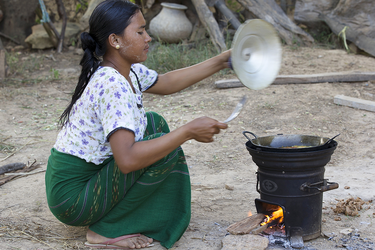 A woman in Myanmars's Dry Zone cooks on an Envirofit SuperSaver wood stove