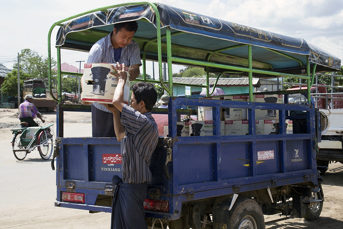 Envirofit cookstoves are unloaded for distribution in Myanmar's Dry Zone