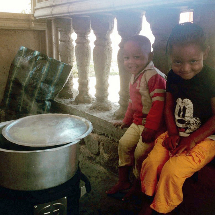 Kids in DRC next to Envirofit Cookstove