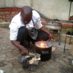 A chef in Lubumbashi compares the SuperSaver Charcoal stove to a locally built model