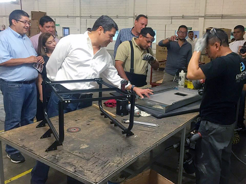 Honduran President Juan Orlando at the Envirofit factory in Tegucigalpa