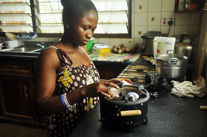 Daina chooses to cook on her charcoal stove instead of the LPG stove she has in her kitchen