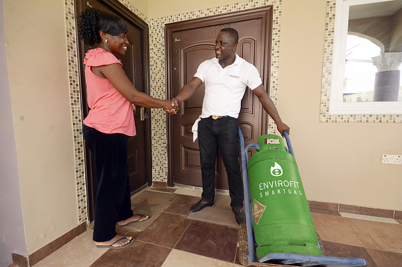 A tank of LPG fuel is delivered to the home of an Envirofit SmartGas customer