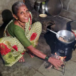 Vatsala uses her Envirofit cookstove in her kitchen