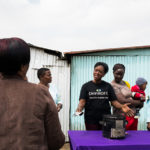 Direct Sales Representative Beatrice Ayoro, speaks about the SuperSaver charcoal stove during a demonstration in Dandora, Kenya