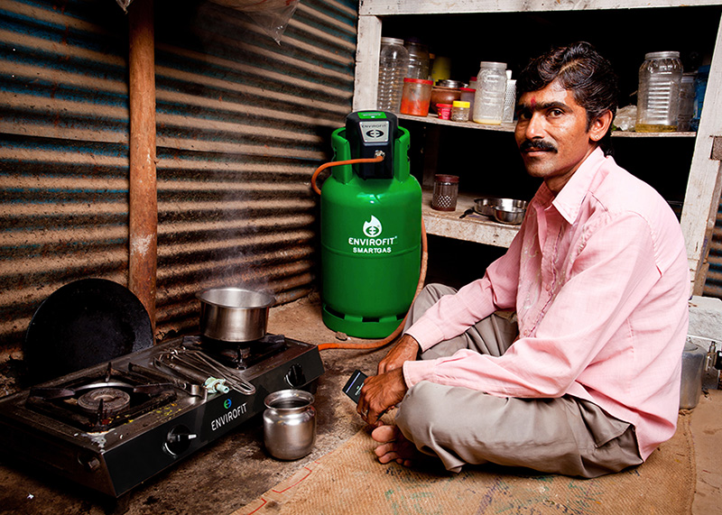 A man cooks using Envirofit SmartGas in his home