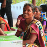 A woman in Kharkharadi, India smiles with her new clena cookstove